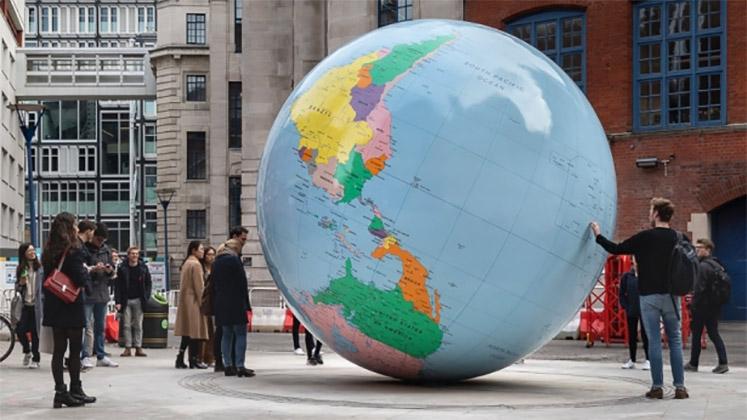 LSE's World Turned Upside Down sculpture by Mark Walllinger