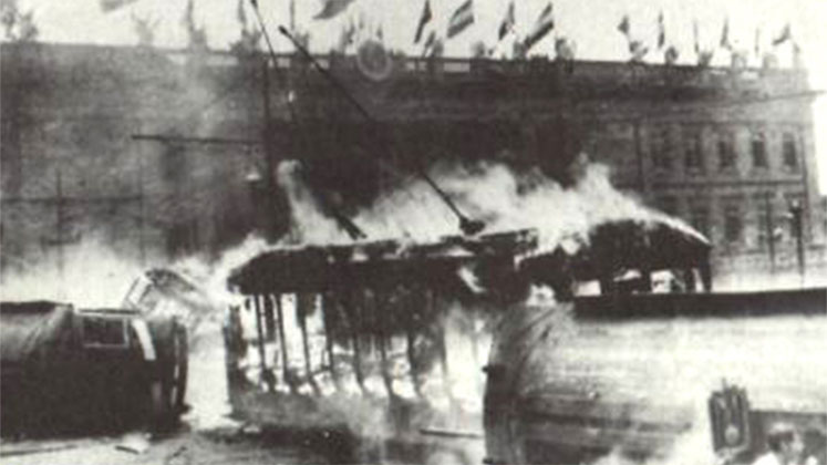 A streetcar lies in flames in front of the Capitolio Nacional during the Bogotazo in 1948