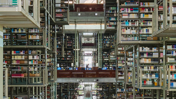 A student walks amongst computers in Mexico City's cavernous Vasconcelos Library