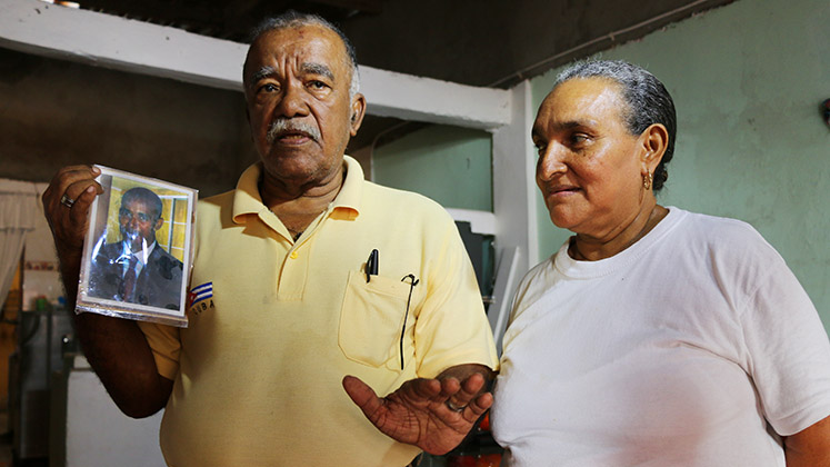 The parents of a disappeared man in Buenaventura, Colombia, holding a photo of him