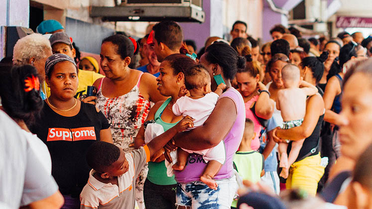 A long queue of mostly women waits outside a store in Havana, Cuba, May 2019