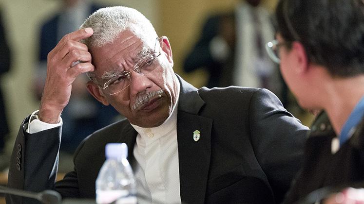 David Granger in conversation at a UN summit on mercury in Geneva, Switzerland