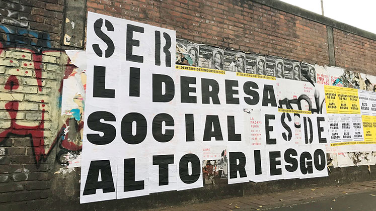 Posters on a wall in Bogota, Colombia, spell out the message 'To be a female leader is a high-risk occupation'