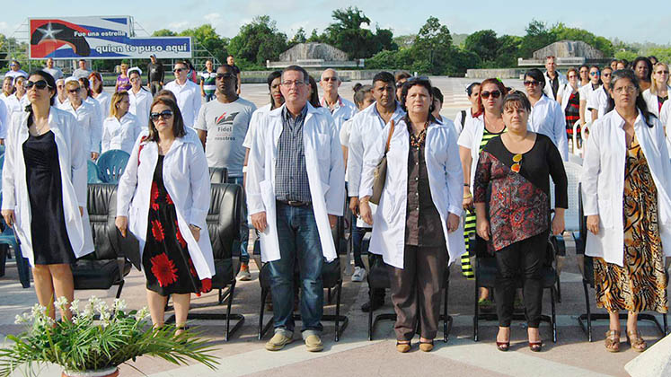 Faculty and medical students at a graduation ceremony in Santa Clara, Cuba