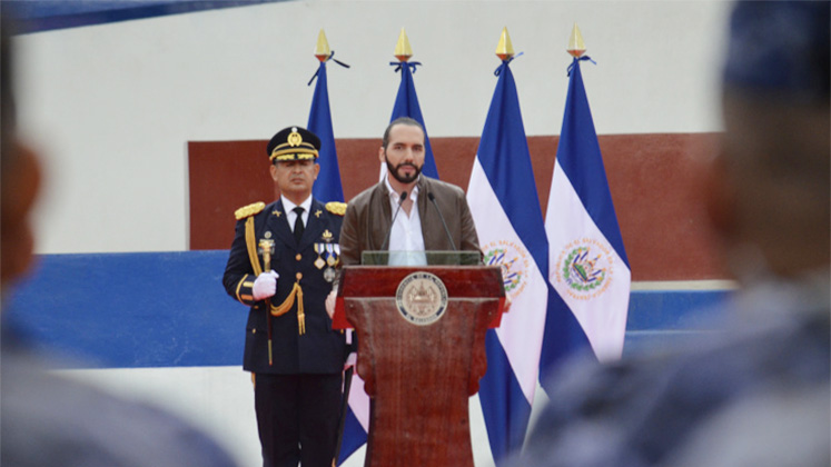 Newly elected President of El Salvador Nayib Bukele receives a baton symbolising control over the country's armed forces