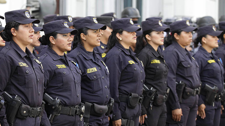 Members of El Salvador's National Civil Police line up for inspection