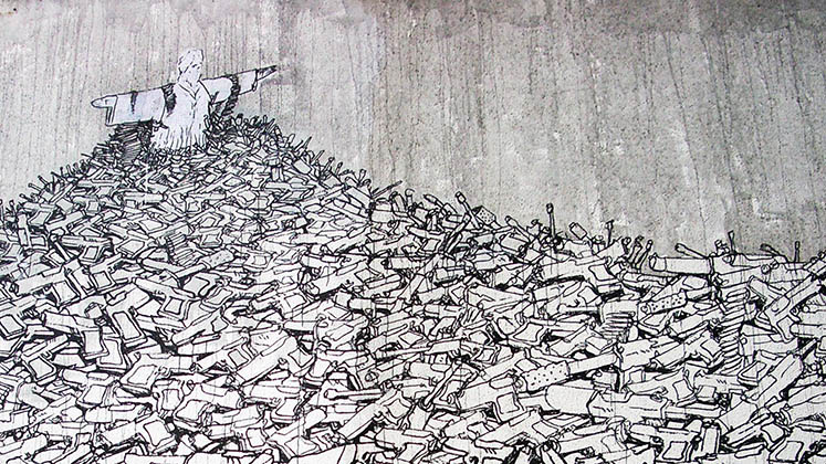 Detail of a mural showing Rio's Christ the Redeemer atop a mountain of guns, by BLU, at SESC Sao Paulo