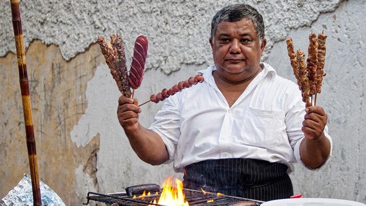 A street vendor in Rio's Vila Canoas favela holds up his wares