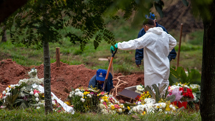 Gravediggers at work in Sao Paulo during the COVID-19 lockdown