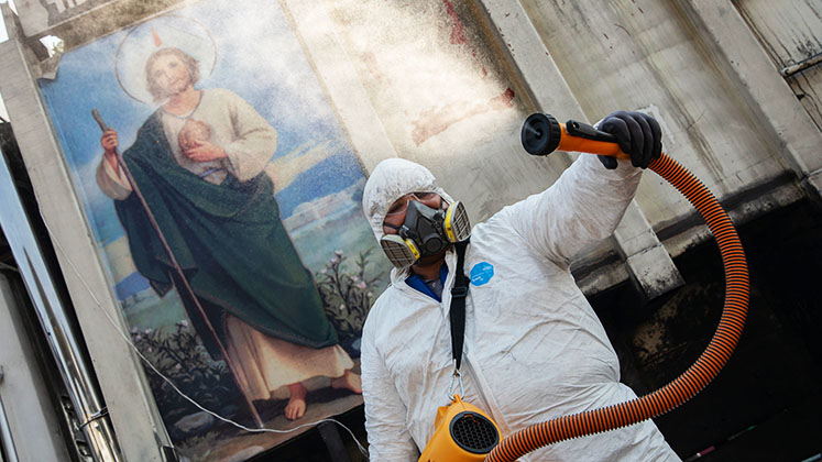 A public health worker sprays disinfectant in Mexico City during the COVID-19 outbreak