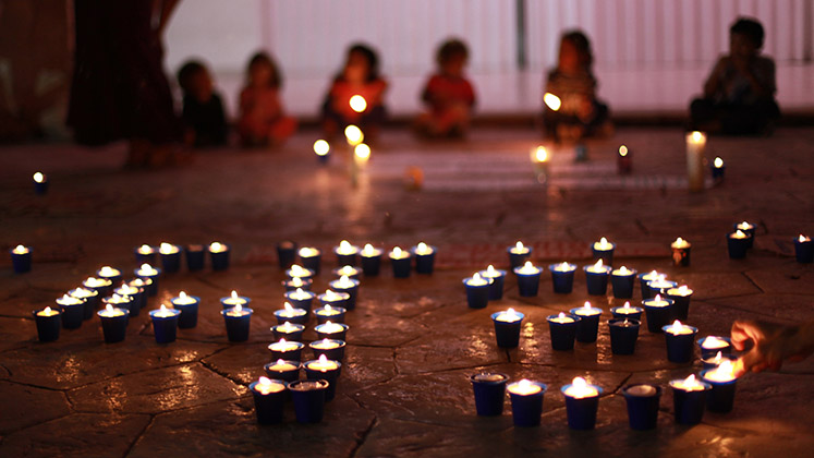 Children in Tulum, Mexico, attend a vigil for the disappeared of Ayotzinapa