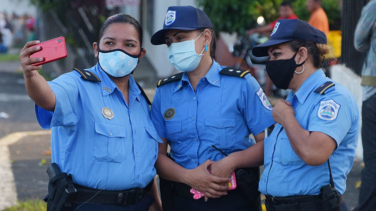 Three masked policewomen in Managua during the COVID-19 crisis