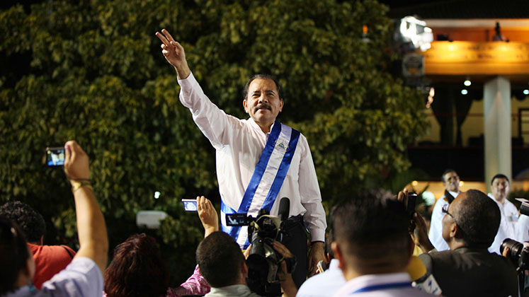 Daniel Ortega surrounded by press at his inauguration as Nicaraguan president in 2012