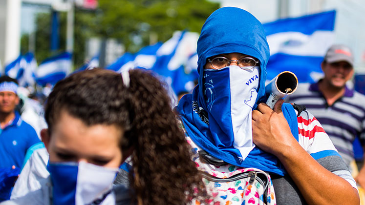 Masked protesters take part in a demonstration against the Ortega government in Nicaragua, in April 2018