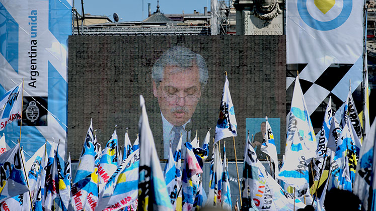 Alberto Fernandez speaks on a large screen in Buenos Aires as he opens regular sessions of the National Congress