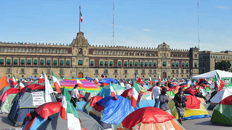 Tents fill Mexico City's main square in front of the National Palace