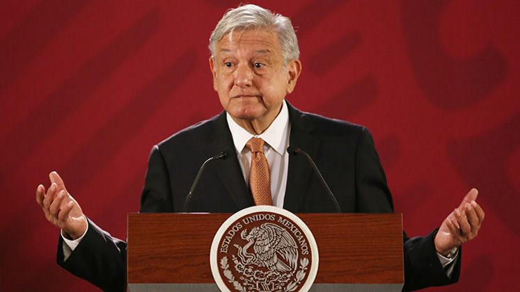 Andrés Manuel López Obrador shrugs during a press conference at Mexico's National Palace