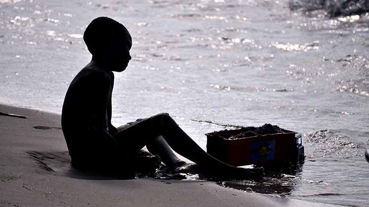 A boy plays in the sand on Colombia's Caribbean coast