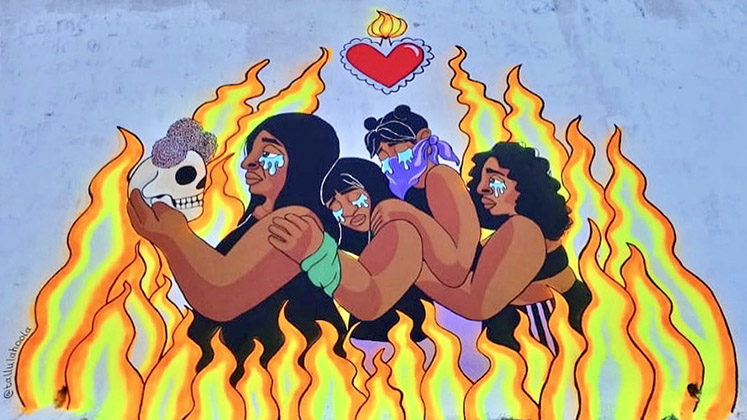 A mural on the State Congress of Quintana Roo showing a group of women crying, surrounded by flames