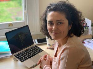 Seckin at her desk