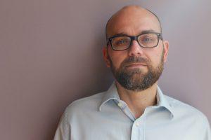 headshot of Claudio Pinheiro