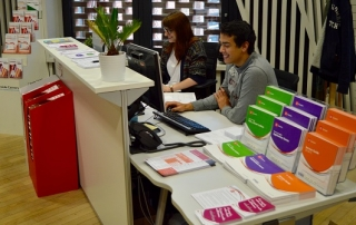 hannah and daniel sitting at the resource centre enquiry desk