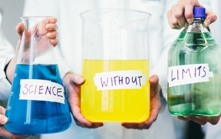 blue yellow and green flasks displaying the words 'science without limits'