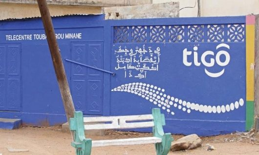 "2.Shopkeeper's Ajami advertisement in Diourbel, Senegal, reads: 'Fii dañu fiy wecciku ay Qasā'id aki band(u) ak kayiti kaamil aki daa"" [Poems, audiocassettes, Quran-copying quality paper and ink are sold here]'. TIGO is a reference to a mobile phone company."