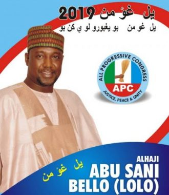 A poster from the 2019 general elections depicts the gubernatorial aspirant in Niger State, Alhaji Abu Sani (Lolo) of the ruling party, APC, who was bidding for the second tern and won. The translation of the Nupe Ajami at the top reads 'Vote Governor 2019', whereas the second line says 'Vote Governor for the Progress of the state'.