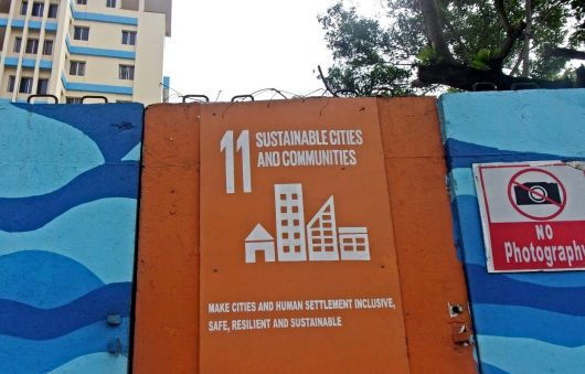 A sign for the sustainable development goals outside a building in Monrovia