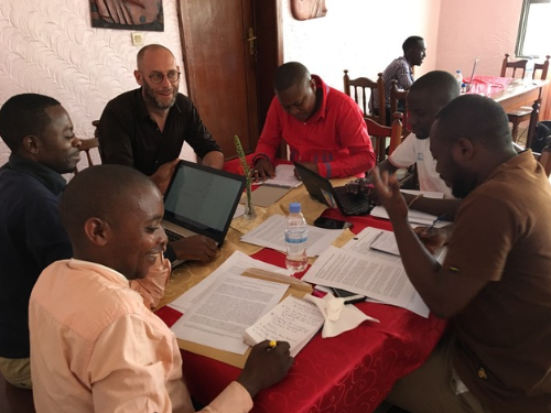 African and European researchers working around a table