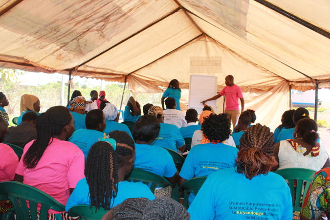 A session on women's empowerment takes place in a community refugee camp