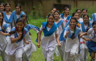 Photo of girls in uniforms running