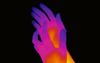 Picture of purple and yellow hands against a black background