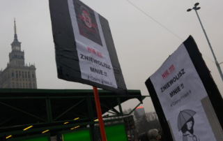 Photo of protest placards in Warsaw