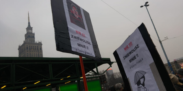 Picture of protesters' placards in Warsaw