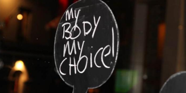 """Photo of sign """"my body my choice!"""""""