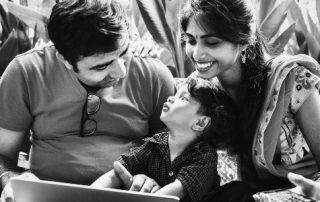 "Image title: ""Indian family using computer together"""