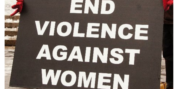 """Protest sign reading """"End Violence Against Women"""""""