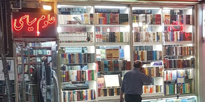 A shopper browsing at a mall made up entirely of bookshops in Enghelab Street, Tehran