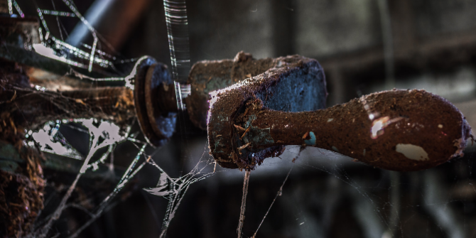 Image of dusty, rusted industry equipment