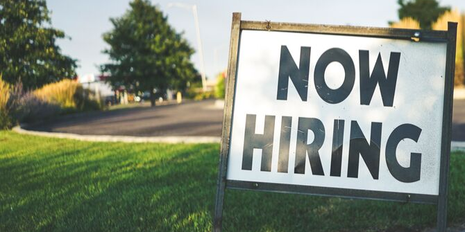 Image of sign reading 'Now Hiring'