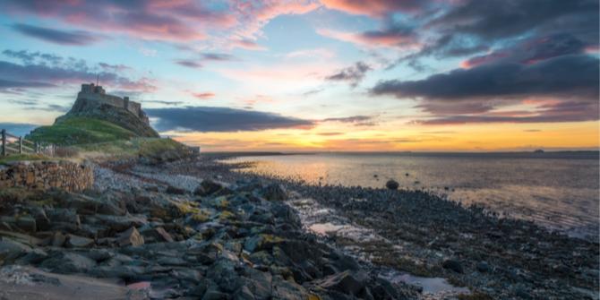 Image of sunrise over the Holy Island of Lindisfarne, Northumberland