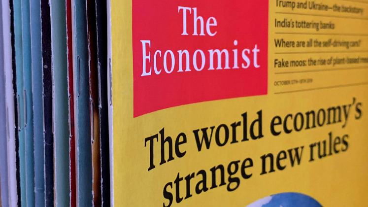 Stack of Economist issues, with the front issue reading 'The World Economy's Strange New Rules'