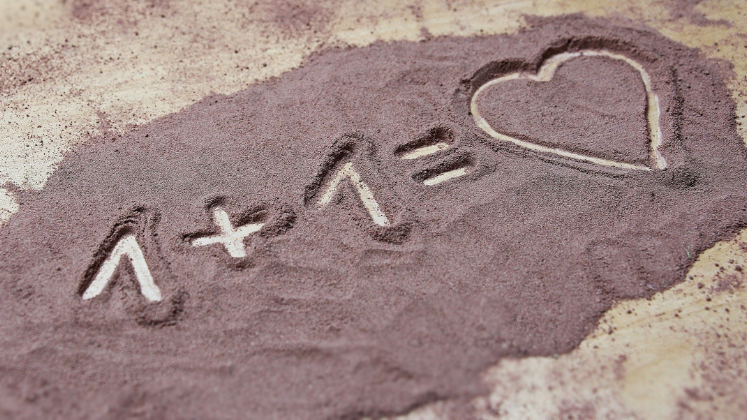 '1 +1 = Heart' drawn into sand
