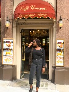Student outside Caffe Concerto Restaurant in London
