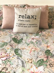 Pillow with writing 'relax'