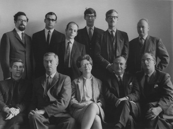 Standing left to right: Robert Hunter, Michael Banks, Philip Windsor, Michael Donelan, Paul Taylor, Alan James. Seated: James Mayall, Geoffrey Goodwin, Coral Bell, Fred Northedge, Peter Lyon