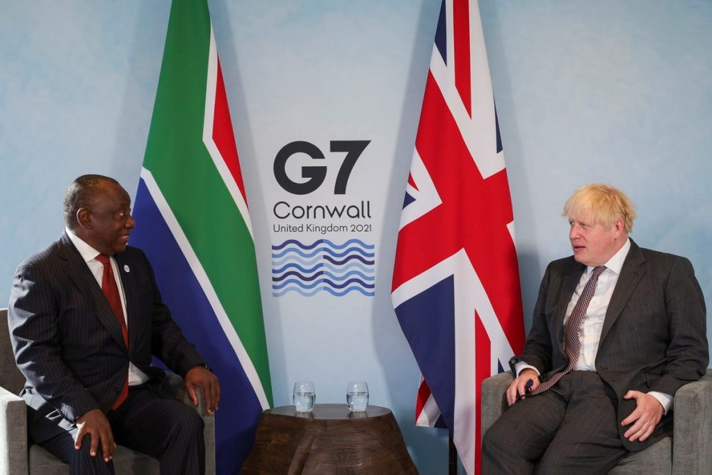 Britain's Prime Minister Boris Johnson and South Africa's President Cyril Ramaphosa attend a bilateral meeting during G7 summit in Carbis Bay, Cornwall, Britain, June 13, 2021.