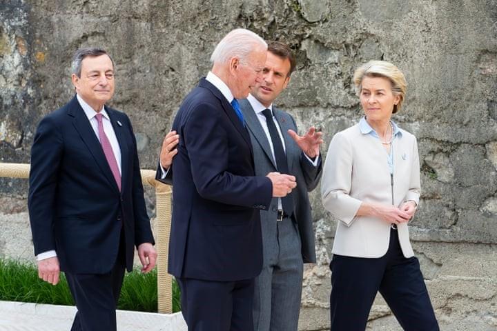 President Joe Biden walks with France's President Emmanuel Macron at G7 summit in Carbis Bay, Cornwall, Britain, June 11, 2021. Photo credit: Jonny Weeks/Pool via REUTERS